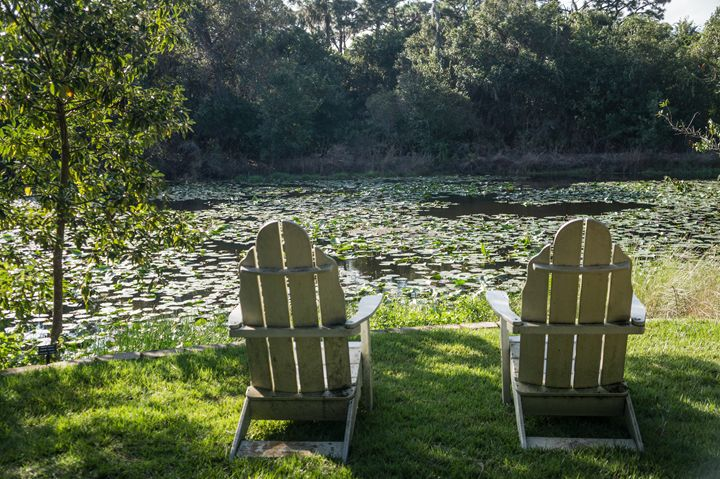 Two Chairs by Peaceful Stream - David J Riffey
