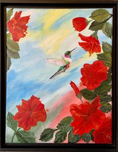 Hummingbird in hibiscus flowers