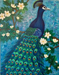 Peacock in flowering tree