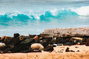 closeup blue wave with sandy beach