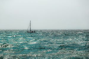 Sailing boat with blue ocean