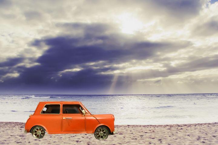 orange car at the sandy beach - TimmyLA