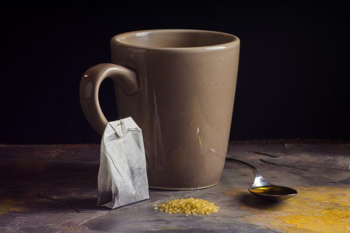 Mug and Spoon of Honey with Tea Bag - StephenJSepan