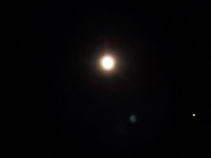 Full moon w/ possible planet visible - James M. Piehl