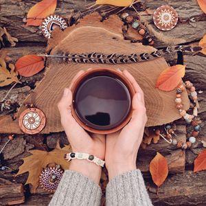 Human Hands Holding Tea Cup