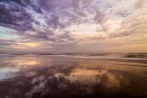 Clouds Reflected on Beach at Sunset