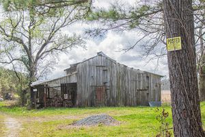 Rusted Wooden Barn on Posted Land