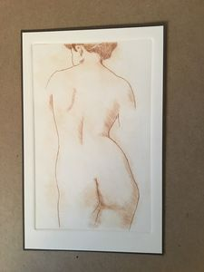 Standing nude from the back