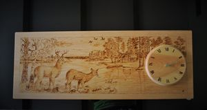 Wood burned clocks with deers