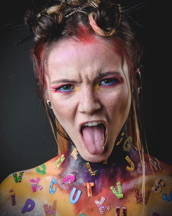 girl with creative alphabet makeup - Faces Studio