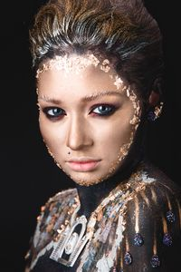 Portrait a girl Golden icon makeup