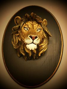 Lion Head sculpture on wood base