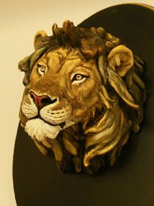 Realistic looking lion head plaque