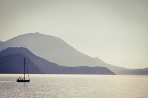 Sea, mountains and a fishermen boat.