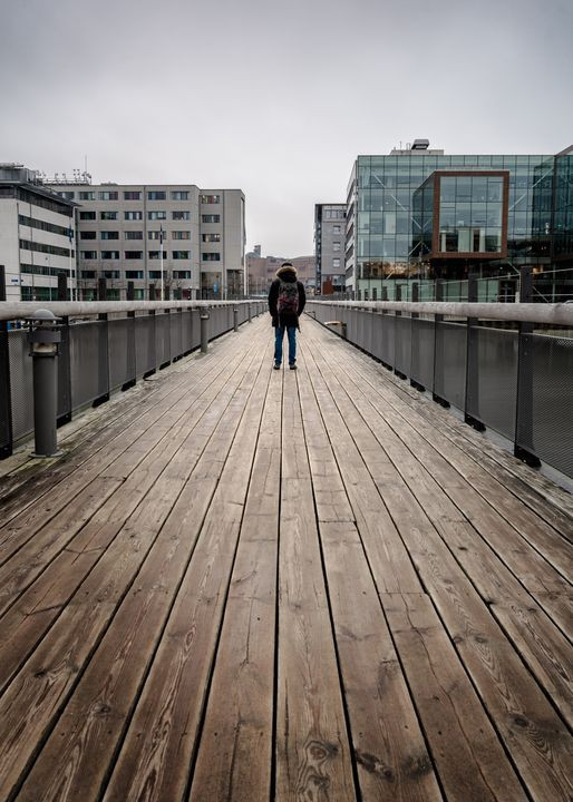 Solo man standing on foot bridge - joisbalu