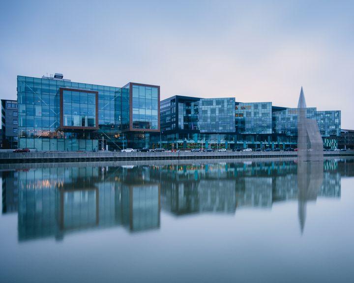Modern buildings reflected in water - joisbalu