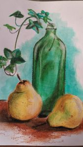 Two ripe pears and a glass bottle
