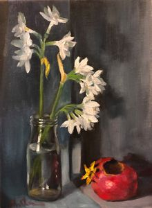 White daffodils and dry pomegranate