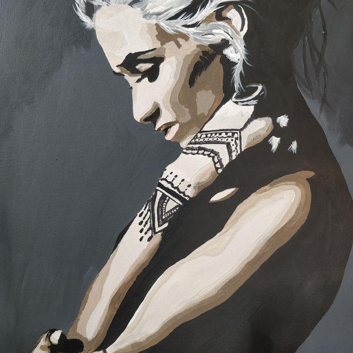 Tattooed figure - Melanie Fiona
