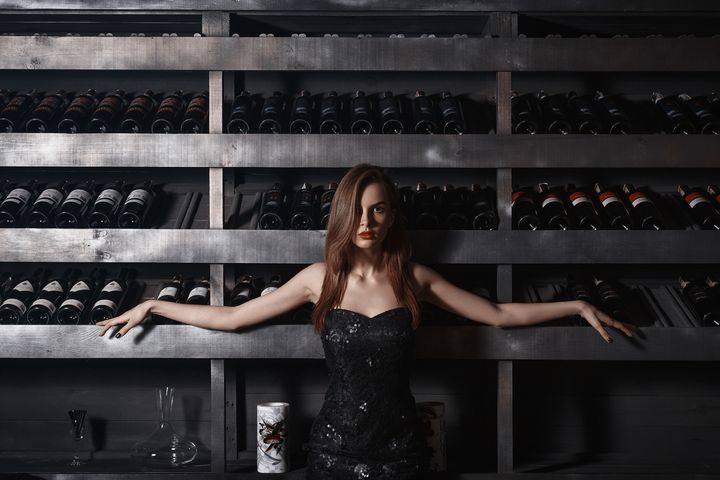 Girl near the wine shelf - KRIVONOS