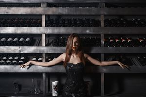 Girl near the wine shelf