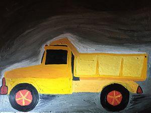 Yellow dump truck at night.