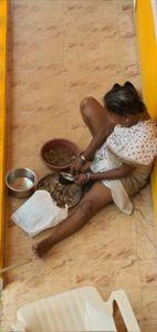 Indian lady shells fish in Apora Goa