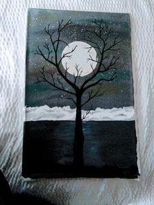 Tree framed winter moon