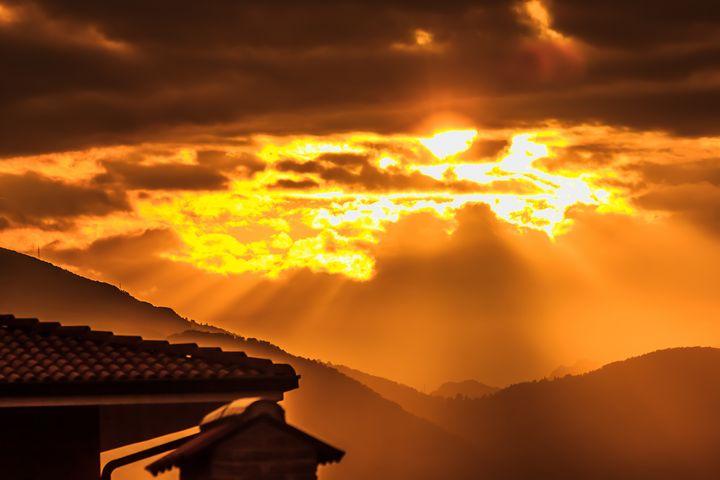 a sunset of threatening clouds - susanna mattioda