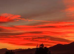 a landscape with a fiery sunset