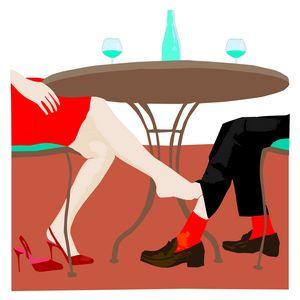 A woman is touching man's leg