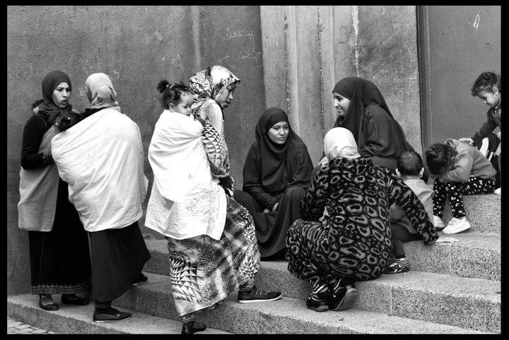 Gossip on the school steps. - MohTaShim