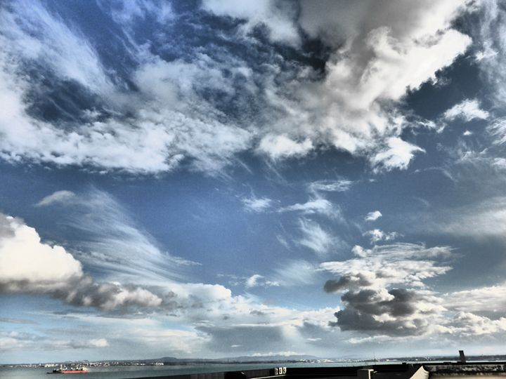 Sky above Tagus River - city child