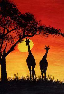 Giraffes at dusk.