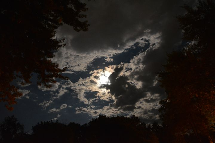 Full moon under clouds - Michelle Stern Photography
