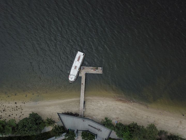 Boat at a small jetty - CaptainMavicPro