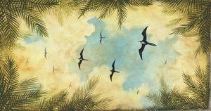 Sky with flying frigate birds.