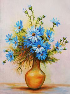 Blue daisies in the vase