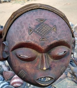 The tattooed mask