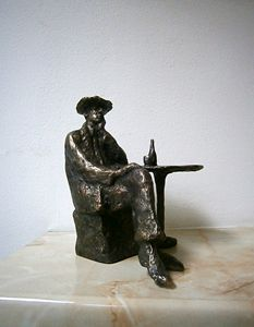 Sitting man with a bottle of wine