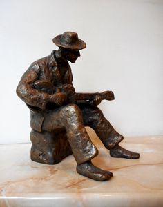 Realistic sculpture of a guitarist