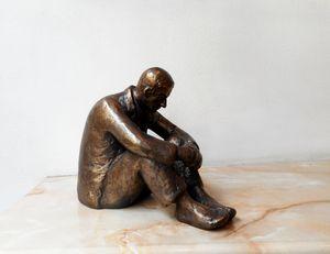 Realistic sculpture of a Sad man