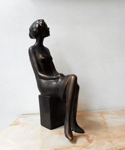 Realistic sculpture of a young woman