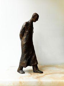 Statuette of a walking man