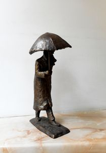 A walking man with an umbrella