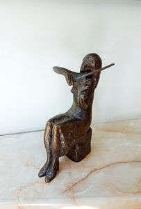 Statuette of a young violinist