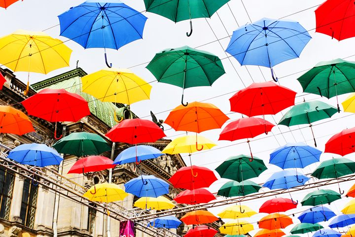 Multicolored umbrellas in the air. - German S
