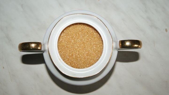Brown cane sugar in an ornamental - Patryk Frey