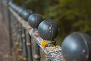 forged lattice fence in the city - Andrey
