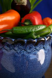 Cobalt blue pot of colorful chilies